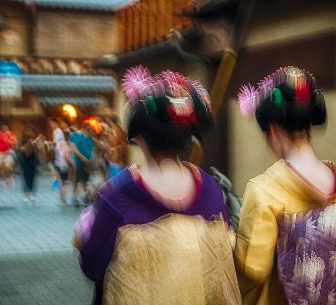 Geishas on movement the neighborhood of Gion, Kyoto. Japan.