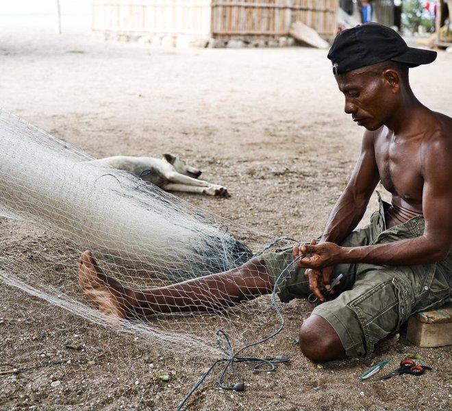 Fishermen from East Timor (East Timor) in Southeast Asia repairi